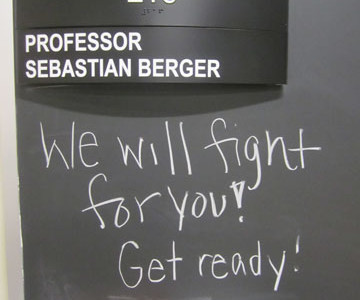 A message on the blackboard outside of Prof. Berger's Althouse office.