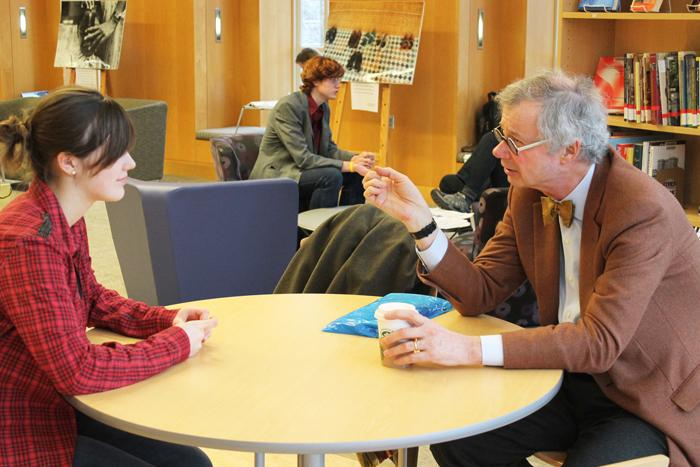 Durden '71 talks with a student during his office hours. His next hours will be held on March 19th.