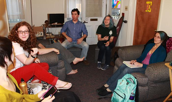 Members of the new SPANKK club talking during their first official meeting in the Spectrum House.