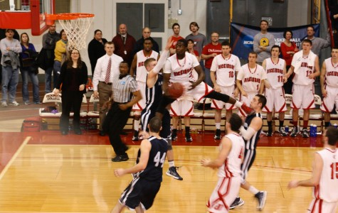Chris Cox '15 takes flight in front of 1,500 fans in the Red Devils' 80-65 NCAA Tournament win.