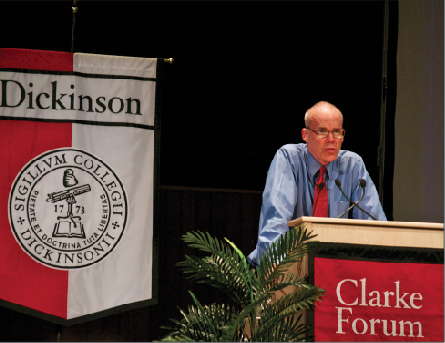 Nationally recognized environmentalist Bill McKibben speaking in front of a crowded auditorium during his lecture on Thursday, April 11.