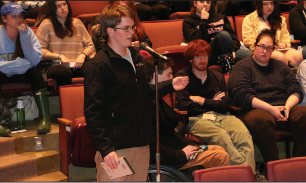 Alex Toole '14 asks a question about the Sexual Misconduct Policy during the 