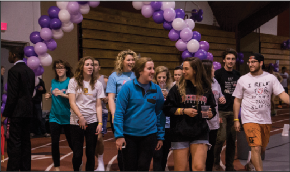 Students+walked+around+the+track+at+the+2014+Relay+for+Life+in+honor+of+those+affected+by+cancer+on+Friday%2C+April+11+until+Saturday%2C+April+12.+The+event+featured+food%2C+activites+and+performances+throughout+the+night.+