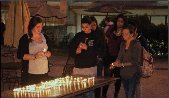 Students light candles at a vigil hosted by the organization J Street U, in remembrance of the lives ended in the conflict between Israel and Hamas.