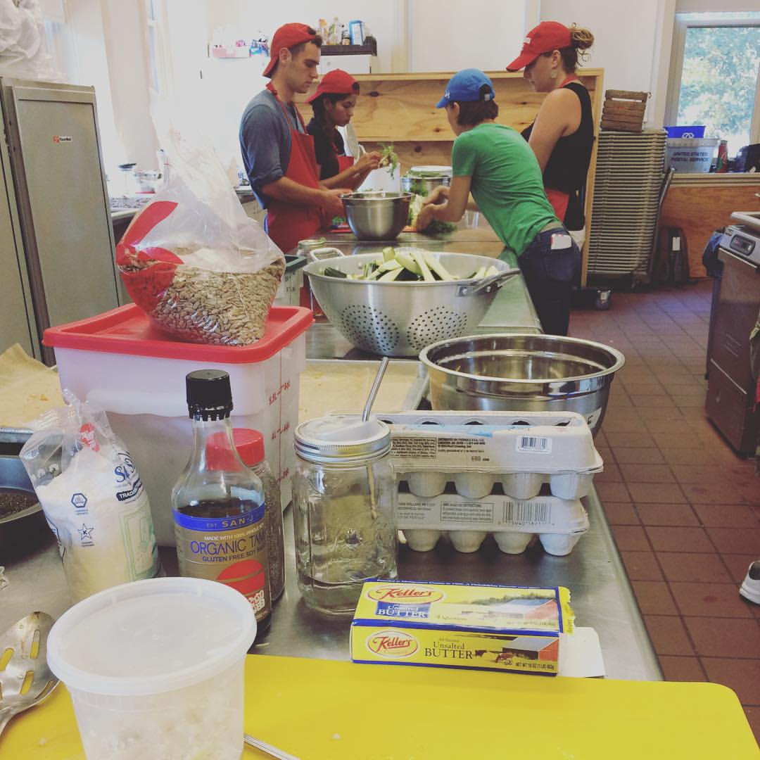 Student farmers Sam Bogan '16, Naviya Kafle '17 and Silvana Kreines '16 prep local ingredients for the first GATHER dinner with chef Tanya McCausland.