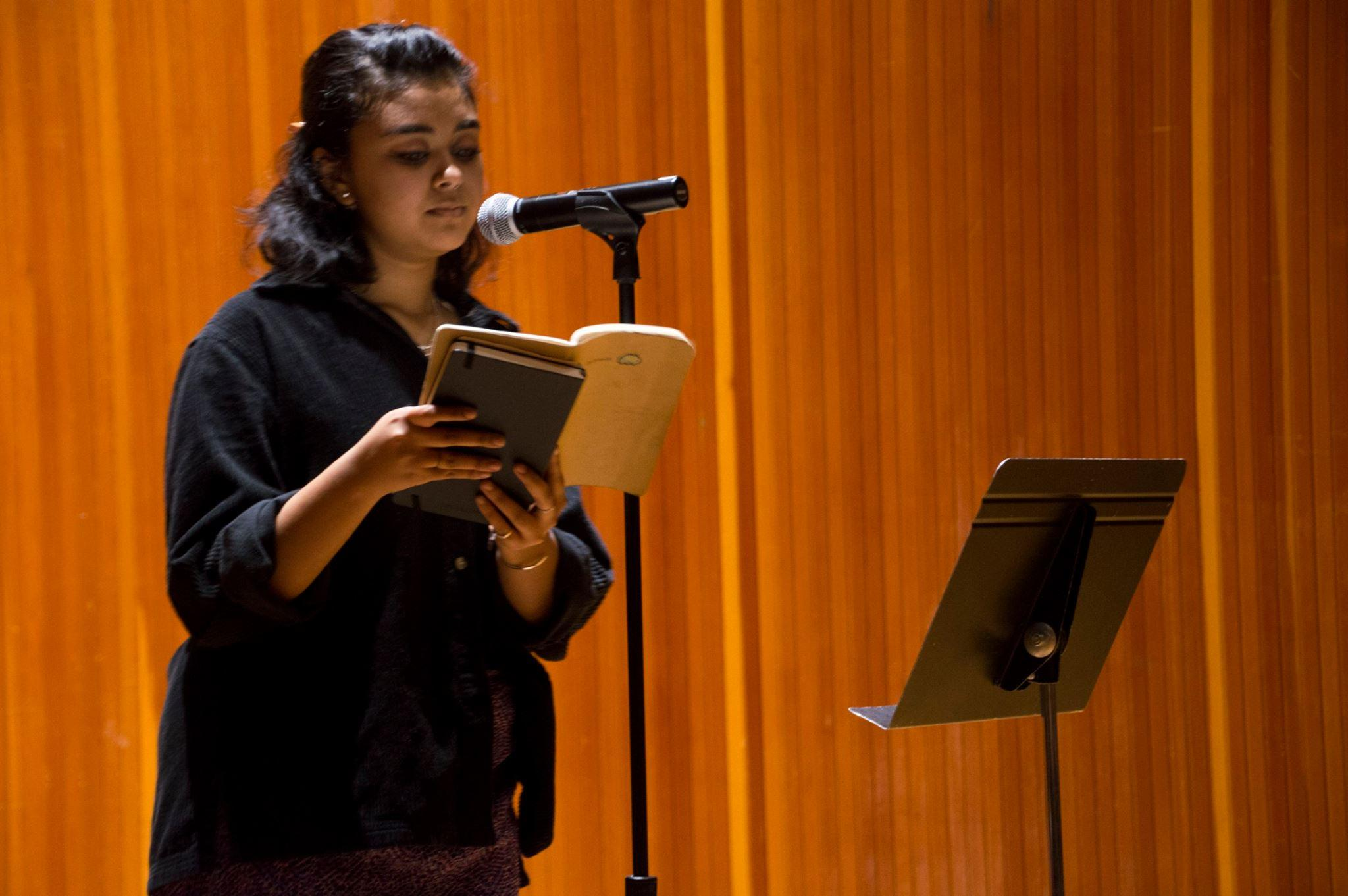 "Student poets and members of Dickinson's poetry club ""eXiled"" Hayat Rasul '19 opened the performance."