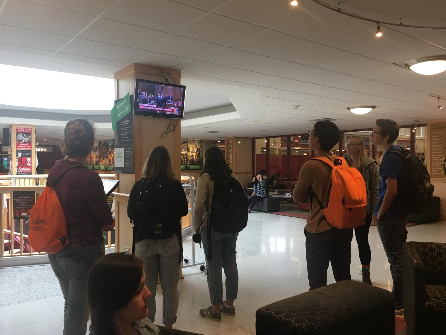 Students in the HUB gather on Thursday, Sept. 27 to watch the testimonies and hearings of Dr. Christine Blasey Ford and Judge Brett Kavanaugh.