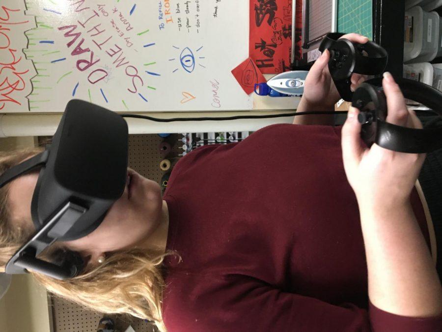 Melanie Hrbek '21 tries out virtual reality.