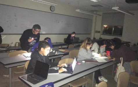 Breaking: Students Study by Flashlight due to Power Outage